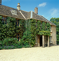 The Virginia creeper-clad exterior of a Georgian rectory in Gloucestershire