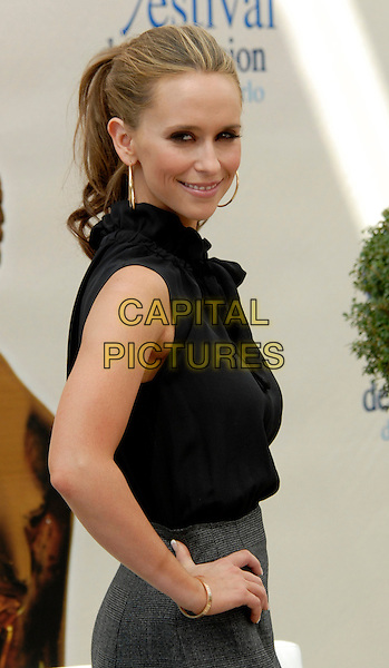 "JENNIFER LOVE HEWITT.Photocall for ""The Ghost Whisperer"" during the 49th Monte Carlo Television Festival at the Grimaldi Forum, Monte-Carlo, Monaco..June 10th, 2009 .half length black sleeveless top blouse hand on hip gold bracelet earrings .CAP/RD.©Richard Dean/Capital Pictures."