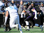 SIOUX FALLS, SD - NOVEMBER 8: Max Mickey #22 from the University of Sioux Falls looks looks for running room past Cole Stephen #53 from Upper Iowa in the first quarter of their game Saturday afternoon at Bob Young Field in Sioux Falls.  (Photo by Dave Eggen/Inertia)
