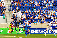 Trinidad and Tobago forward Kenwyne Jones (9) goes up for a header with El Salvador midfielder Jaime Alas (16) during a CONCACAF Gold Cup group B match at Red Bull Arena in Harrison, NJ, on July 8, 2013.
