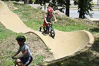 Sawyer Keedy, 6, (left) and his little brother Greyson Keedy, 5, ride their bicycles at the pump track at Gregory Park in Fayetteville Sunday July 26, 2020. Gregory Park is a 19-acre wooded parcel located off College Avenue on Sycamore Street. The brothers were at the park with their parents Matt and Amanda Keedy of Fayetteville. The family often uses the park and likes it's trails and shade trees. Visit nwaonline.com/200726Daily/ for photo galleries. (NWA Democrat-Gazette/J.T. Wampler)