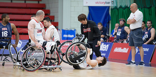 03.07.2016. Leicester Sports Arena, Leicester, England. Continental Clash Wheelchair Basketball, USA versus Japan.  . Shingo Fujii (JPN) falls and gets caught between Mitsugu Chiwaki (JPN) wheelchair