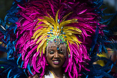 London, UK. 28 August 2017. Dancer from People's World. Notting Hill Carnival celebrations and parade on Bank Holiday Monday. The festival attacts usually over 1 million visits and this year it remembers the victims of the Grenfell Tower fire.