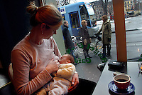 Milk and coffee. Breastfeeding in public is common in Norway, and Ludvig enjoys his milk while his mother Sophie Aaserud waits for a chance to finish her coffee..In contrast to most European countries, the Norwegian birth rate is a healthy 1.9. Norway's reputation as a child friendly society is partially founded on a succession of government initiatives to improve parents' rights and economic circumstances.