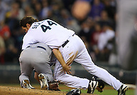 Texas Rangers' starting pitcher Kason Gabbard is tackled Seattle Mariners' batter Richie Sexson when he threw a pitch close to Sexson in the fourth inning of a MLB baseball game in Seattle on Thursday May 8, 2008. (AP Photo/Kevin P. Casey)