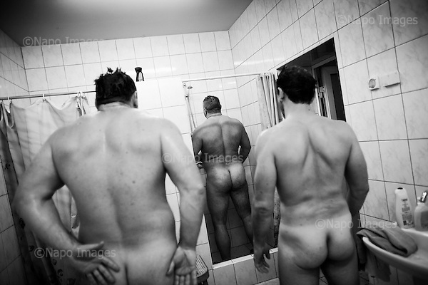 Krotoszyn 02.10.2010 Poland<br /> Sumo fighters are waiting for their turn in the shower.<br /> Poles do not know much about sumo. Japan's national sport remains a mystery, except for the image of the very big and fat sumo wrestlers. However Polish sumo wrestlers have been, for many years, classified among world's leading sportsmen in this field. Since 1995 more and more followers join the sumo sections, fascinated with the art of fighting on the clay dohyo.<br /> Photo: Adam Lach / Napo Images<br /> <br /> Zawodnicy sumo czekaja na swoja kolej pod prysznicem.<br /> Polacy niewiele wiedza o sumo. Narodowy sport Japonii to wciaz tajemnica. Kojarzy sie jedynie z wielkimi i grubymi mezczyznami. Jednak zawodnicy z Polski od lat naleza do swiatowej czolowki w tej dyscyplinie. Od 1995 roku w sekcjach sumo przybywa zawodnik&oacute;w zafascynowanych zmaganiami na glinianym dohyo.<br /> Fot: Adam Lach / Napo Images