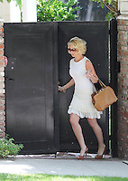 Katherine Heigl wore a caramel studded leather tote by Valentino and a summerly white dress as she stepped out for lunch today with her mom_Nancy. Los Angeles, California on 08.05.2012..Credit: Correa/face to face.. /MediaPunch Inc. ***FOR USA ONLY***