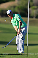 Michael Hoey (NIR) chips onto the 7th green during Thursday's Round 1 of the 2016 Portugal Masters held at the Oceanico Victoria Golf Course, Vilamoura, Algarve, Portugal. 19th October 2016.<br /> Picture: Eoin Clarke | Golffile<br /> <br /> <br /> All photos usage must carry mandatory copyright credit (&copy; Golffile | Eoin Clarke)
