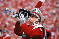 A member of the UW Marching Band performs during halftime at a football game in Camp Randall Stadium.<br /> <br /> Client: University of Wisconsin-Madison<br /> &copy; UW-Madison University Communications 608-262-0067<br /> Photo by: Michael Forster Rothbart<br /> Date:09/02     File#:   color slide.