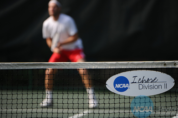 14 MAY 2010: Matt Legend of Valdosta State serves against Barney Buzzard of Barry University during the Division II Men's Tennis Championship held at Sanlando Park in Altamonte Springs, FL.  Valdosta State defeated Barry 5-2 to win the national title. Joshua Duplechian/ NCAA Photos