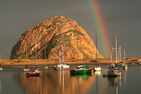 After a spring rain, a rainbow arcs over Morro Rock at Morro Bay on the California central coast.