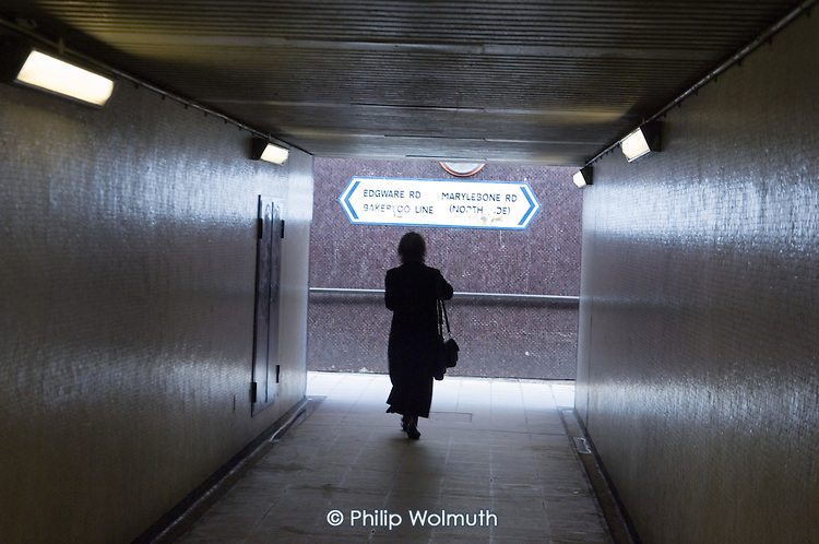 A woman walks through a Marylebone Road pedestrian subway