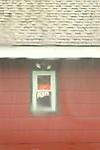 Coors Light beer sign in bar window in rainstorn.