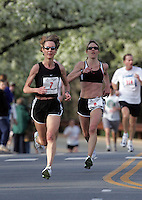 Eliza O'Connell, right, watches as Andrea Wright, left, become the women's champion for the Charlottesville 10-miler Saturday in Charlottesville, Va. Photo/Andrew Shurtleff