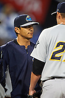 Trenton Thunder pitching coach Jose Rosado (50) talks with pitcher Alex Smith (21) during a game against the Binghamton Mets on August 8, 2015 at NYSEG Stadium in Binghamton, New York.  Trenton defeated Binghamton 4-2.  (Mike Janes/Four Seam Images)