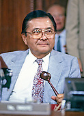 United States Senator Daniel K. Inouye (Democrat of Hawaii), Chairman of the Senate Select Committee on Secret Military Assistance to Iran and the Nicaraguan Opposition, holds his gavel as he prepares to call the committee to order during a Summer, 1987 hearing.  Senator Inouye passed away due to respiratory complications at Walter Reed National Military Medical Center in Bethesda on Monday, December 17, 2012. He was 88..Credit: Ron Sachs / CNP