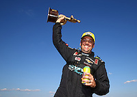 Sep 20, 2014; Ennis, TX, USA; NHRA pro stock driver Jonathan Gray celebrates after winning the rescheduled Carolina Nationals as a part of qualifying for the Fall Nationals at the Texas Motorplex. The race was originally scheduled at zMax Dragway in Concord, NC but was moved due to track conditions. Mandatory Credit: Mark J. Rebilas-USA TODAY Sports