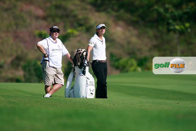 Joost Luiten (NED) and caddy wait to play his 2nd shot on the 14th hole during Thursday's Round 1 of the 2011 Iskandar Johor Open, Horizon Hills Golf Club, Johor, Malaysia, 15th November 2011 (Photo Eoin Clarke/www.golffile.ie)