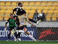 Leo Bertos clears under pressure from Jin-Hyung Song during the A-League match between Wellington Phoenix and Newcastle Jets at Westpac Stadium, Wellington, New Zealand on Sunday, 4 January 2009. Photo: Dave Lintott / lintottphoto.co.nz