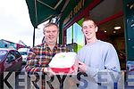 Dan Horan and Chris Carmody with one of the Christmas Cakes on offer at Horans Fruit and Veg Listowel.