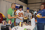 Redskins James Thrash signs at the Home & Leisure Show on October 16, 2011 at the Capital Clubhouse, Waldorf, Maryland. (Photo by Sue Coflin/Max Photos)
