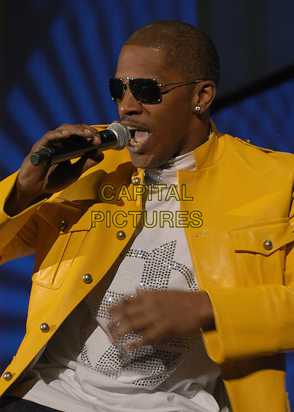 JAMIE FOXX.Oscar winner Jamie Foxx performs at the Norfolk Scope, Norfolk, Virginia, USA, 22 March 2007..half length mouth open microphone yellow leather jacket singing concert gig.CAP/ADM/MK.©Mike Klein/AdMedia/Capital Pictures.