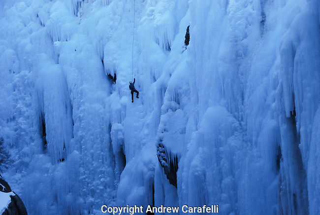 An ice climber makes his way up a cascade of frozen waterfalls in Ouray, Colorado.