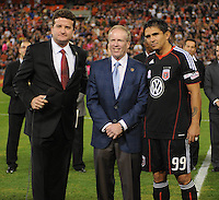 DC United forward Jaime Moreno (99) left with DC United President and CEO Kevin Payne and sports broadcaster  Dabe Johnson at the presentation for Jaime Moreno last game.  Toronto FC. defeated DC United 3-2 at RFK Stadium, October 23, 2010.
