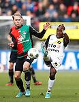 Nederland, Nijmegen, 2 december 2012.Eredivisie .Seizoen 2012-2013.N.E.C.-NAC Breda.Nathaniel Will (l.) van N.E.C. en Elson Hooi (r.) van NAC Breda strijden om de bal.