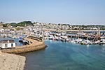 Boats at moorings in the harbour of fishing port of Newlyn, Cornwall, England, UK
