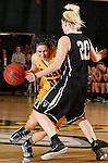 JANUARY 23, 2015 -- Dakota Barrie #32 of Black Hills State drives into Abby Kirchoff #20 of UC-Colorado Springs during their Rocky Mountain Athletic Conference women's basketball game Friday at the Donald E. Young Center in Spearfish, S.D. (Photo by Dick Carlson/Inertia)