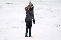 Pictured: A lady enjoys herself in the snow at Libanus, in Brecon, Wales, UK. Friday 01 February 2019<br /> Re: Heavy snow and freezing temperatures affecting parts of the UK.