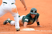 Dartmouth Big Green outfielder Bo Patterson (33) dives back to first during a game against the University of Alabama at Birmingham Blazers at Chain of Lakes Stadium on March 17, 2013 in Winter Haven, Florida.  Dartmouth defeated UAB 4-0.  (Mike Janes/Four Seam Images)