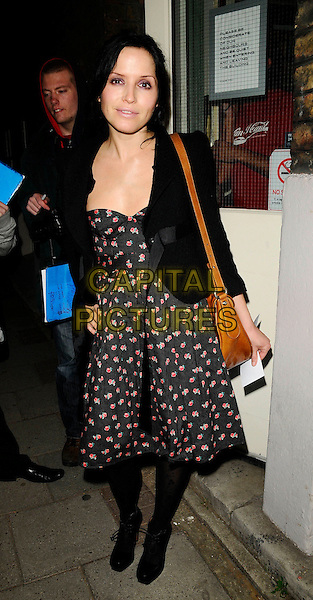 "ANDREA CORR .At the ""Dancing At Luchnasa"" Press Night, Old Vic Theatre, The Cut, London, England, March 5th 2009..full length black jacket rose red floral flower print dress brown shoulder bag .CAP/CAN.©Can Nguyen/Capital Pictures"