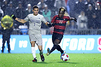 CARY, NC - DECEMBER 13: Ousseni Bouda #11 of Stanford University plays the ball away from Rio Hope-Gund #2 of Georgetown University during a game between Stanford and Georgetown at Sahlen's Stadium at WakeMed Soccer Park on December 13, 2019 in Cary, North Carolina.