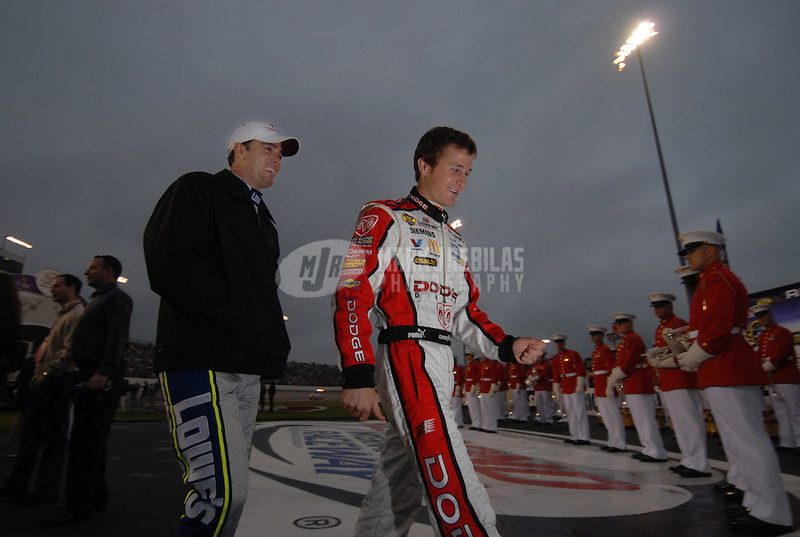 May 5, 2007; Richmond, VA, USA; Nascar Nextel Cup Series driver Kasey Kahne (9) talks with Jimmie Johnson (48) prior to the Jim Stewart 400 at Richmond International Raceway. Mandatory Credit: Mark J. Rebilas-US PRESSWIRE Copyright © 2007 Mark J. Rebilas