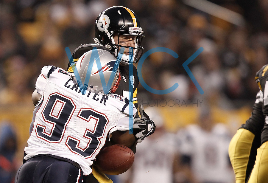 PITTSBURGH, PA - OCTOBER 30: Ben Roethlisberger of the Pittsburgh Steelers is sacked and stripped by Andre Carter #93 of the New England Patriots during the game on October 30, 2011 at Heinz Field in Pittsburgh, Pennsylvania.  (Photo by Jared Wickerham/Getty Images)