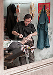 The Barber Shaves Another Customer 01 - Traditional barber in Hoi An, Viet Nam