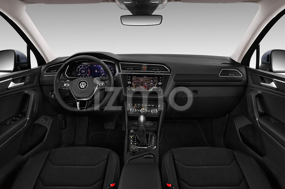 Stock photo of straight dashboard view of a 2018 Volkswagen Tiguan Allspace Highline 5 Door SUV