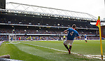 Fraser Aird takes a corner kick with the Bill Struth main stand in the background