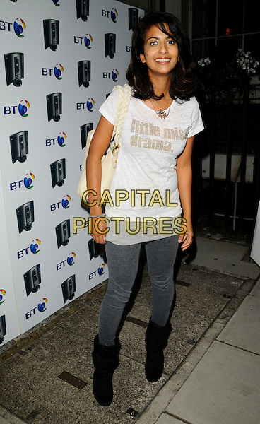 "KONNIE HUQ.At the BT Total Broadband House Launch Party, In & Out Club, St. James Square, London, England, .14th July 2008..full length grey gray leggings white ""Little Miss Drama"" t-shirt boots slogan bag.CAP/CAN.©Can Nguyen/Capital Pictures"