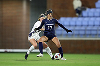 CHAPEL HILL, NC - NOVEMBER 16: Isabel Cox #13 of the University of North Carolina is defended by Rachel Vernon #21 of Belmont University during a game between Belmont and North Carolina at UNC Soccer and Lacrosse Stadium on November 16, 2019 in Chapel Hill, North Carolina.