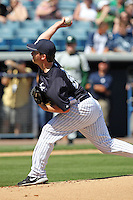 New York Yankees pitcher Adam Warren #86 delivers a pitch during a scrimmage against the USF Bulls at Steinbrenner Field on March 2, 2012 in Tampa, Florida.  New York defeated South Florida 11-0.  (Mike Janes/Four Seam Images)