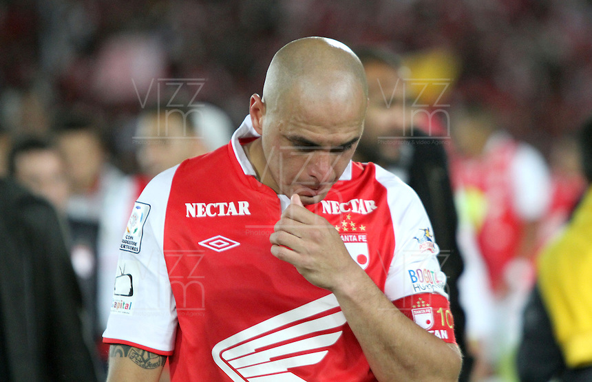 BOGOTA -COLOMBIA, 9-07-2013. Tristeza de los jugadres  de Santa Fe de Colombia al ser eliminados por  Olimpia de Paraguay  , partido de la semifinal de la Copa Bridgestone  Libertadores de Am&eacute;rica , jugado en el estadio Nemesio Camacho El Camp&iacute;n de la ciudad de Bogot&aacute;./ players sadness Santa Fe of Colombia to be eliminated by Olimpia of Paraguay, semifinal match of the Copa Libertadores Bridgestone, played at the Estadio Nemesio Camacho El Campin in Bogota.<br /> . Photo: VizzorImage/ Felipe Caicedo/ STAFF