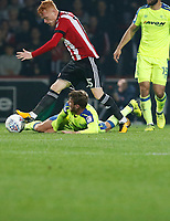 Ryan Woods of Brentford fells Andreas Weimann of Derby County during the Sky Bet Championship match between Brentford and Derby County at Griffin Park, London, England on 26 September 2017. Photo by Carlton Myrie / PRiME Media Images.
