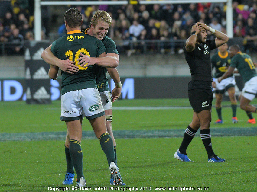 South Africa's Pieter-Steph du Toit congratulates Handre Pollard on his conversion to draw the match 16-all during the Rugby Championship rugby union match between the New Zealand All Blacks and South Africa Springboks at Westpac Stadium in Wellington, New Zealand on Saturday, 27 July 2019. Photo: Dave Lintott / lintottphoto.co.nz