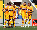 Motherwell players argue in the box as they all vie to take the penalty