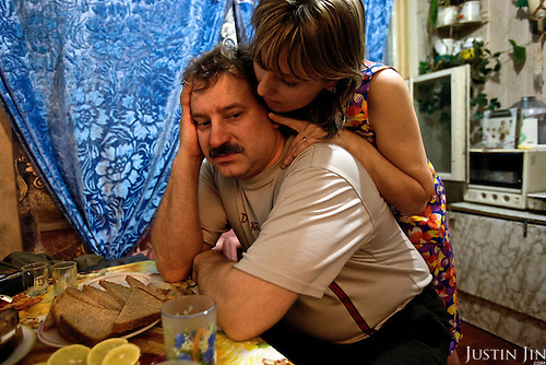 Valery Zhukov, a miner and union representative in Severny village outside Vorkuta, is comforted by his lover Lena.<br /> Vorkuta is a coal mining and former Gulag town 1,200 miles north east of Moscow, beyond the Arctic Circle, where temperatures in winter drop to -50C. <br /> Here, whole villages are being slowly deserted and reclaimed by snow, while the financial crisis is squeezing coal mining companies that already struggle to find workers.