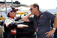 Greg Biffle (#16) and broadcaster Ray Evernham talk in the garage area.