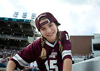 Young MSU fan smiling during the Maroon and White football game. <br />  (photo by Lizzy Powers / &copy; Mississippi State University)
